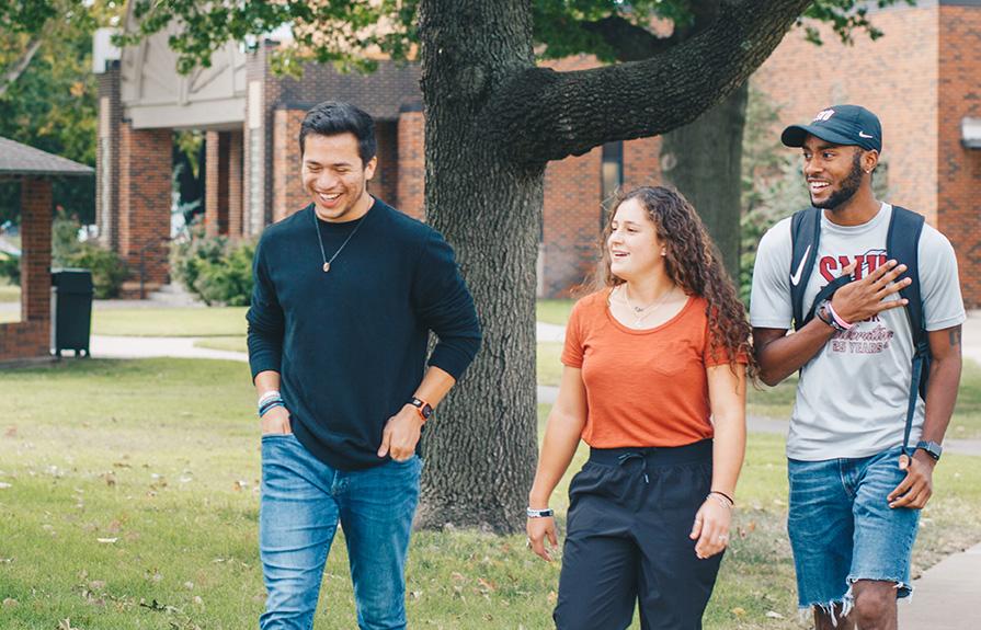 Three SNU students walking across campus