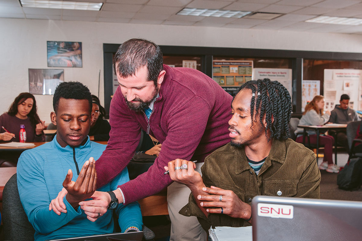 Students examine arms in class