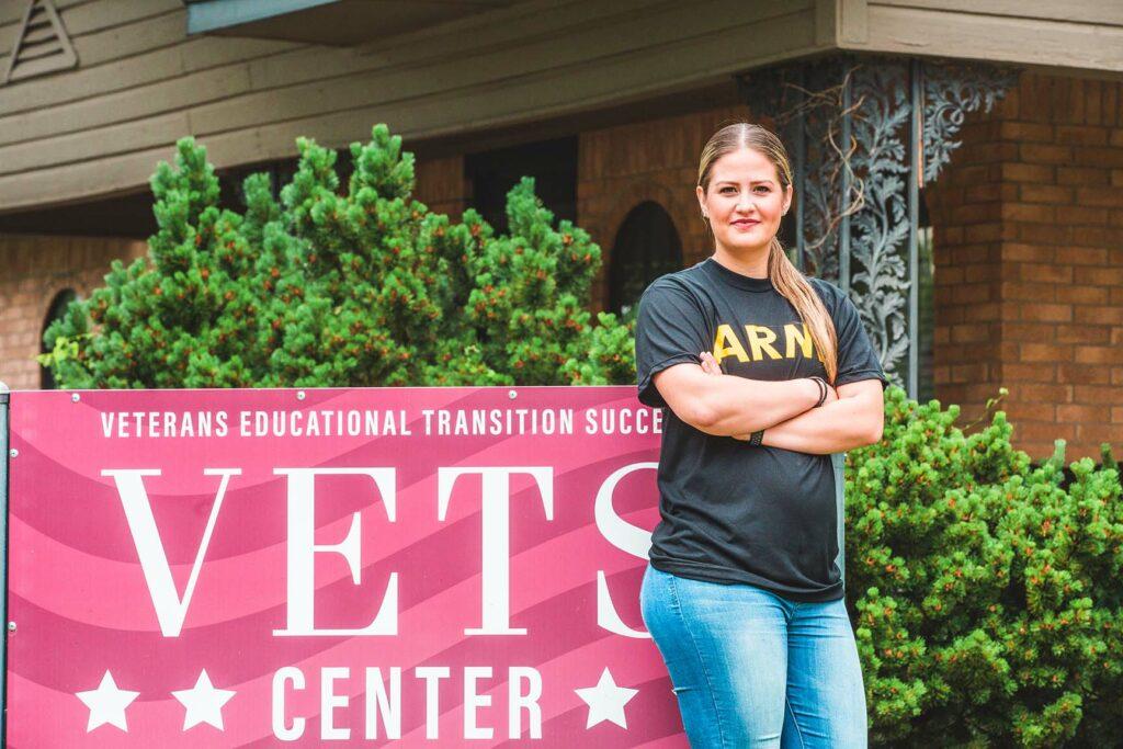 Female Veteran standing next to SNU VETS Center