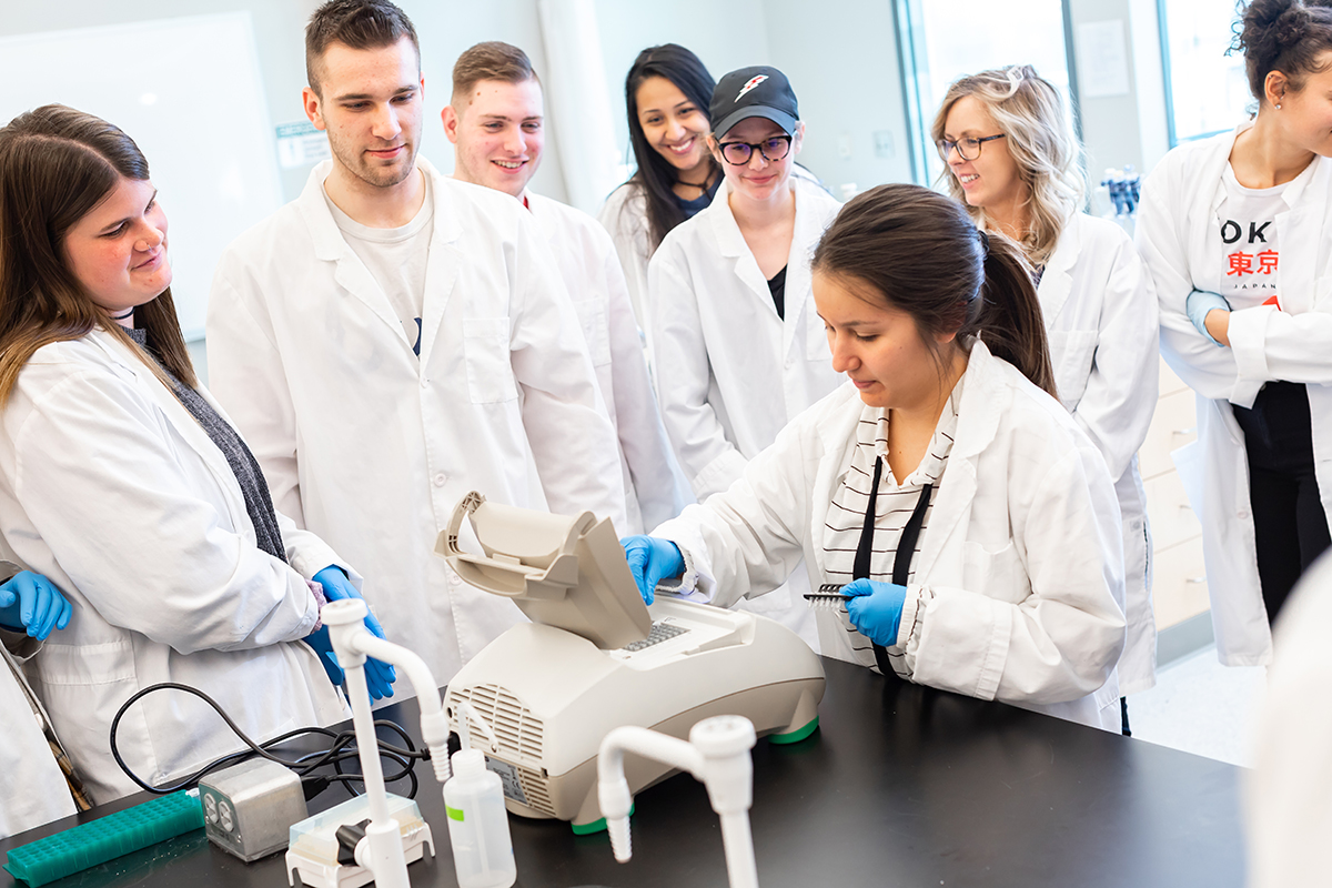science students gathered around a lab table in class