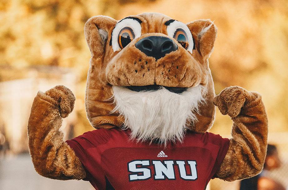 SNU Crimson Storm Mascot flexing muscles